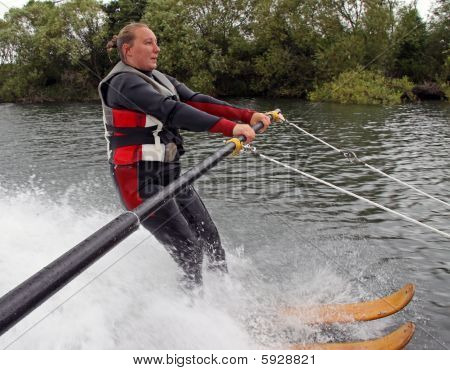 Young woman learning to water ski