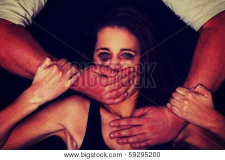 Emotional portrait of abused woman isolated on black