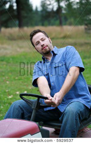 Man On Lawn Mower