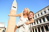 picture of san valentine  - Romantic couple in love having fun embracing and laughing doing piggyback ride in Venice - JPG