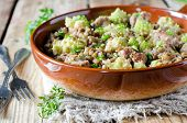 stock photo of romanesco  - Green lentils with homemade sausage and cabbage romanesco