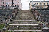 stock photo of old stone fence  - front closeup view of old stone staircase on Neva river embankment in St - JPG