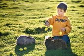 stock photo of little boys only  - Little boy feeding two rabbits in farm - JPG