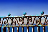 picture of balustrade  - blue rusty balustrade on the sea front - JPG