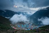 stock photo of sherpa  - View to sherpa capital Namche Bazar at sunset - JPG
