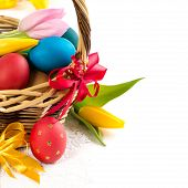 Easter basket with Easter Eggs and tulips