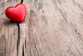 picture of love hurts  - Red heart in crack of wooden plank - JPG