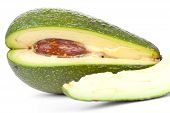 picture of avow  - Whole avacado and slice closeup on white - JPG