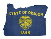 Grunge state of Oregon flag map isolated on a white background, U.S.A.