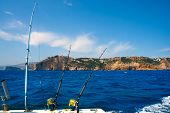 pic of troll  - Fishing trolling boat rods in Mediterranean Cabo Nao Cape at Alicante Spain - JPG