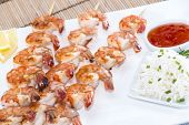 stock photo of tiger prawn  - Skewered Tiger Prawns with a portion of fresh Rice - JPG
