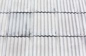 stock photo of asbestos  - Corrugated grey asbestos cement roof tile  - JPG