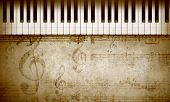 pic of clefs  - Conceptual image with piano keys and music clef - JPG