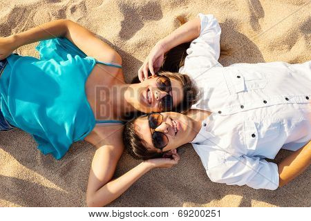 Couple Joining Heads On Beach