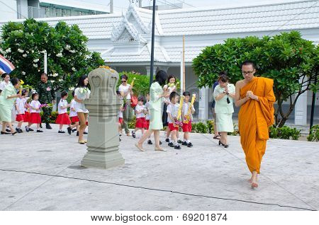 Bangkok ,thailand - 9 July 2014 : Unknown Monk Lead People In School Fot Buddhism Ritual Around  Wat
