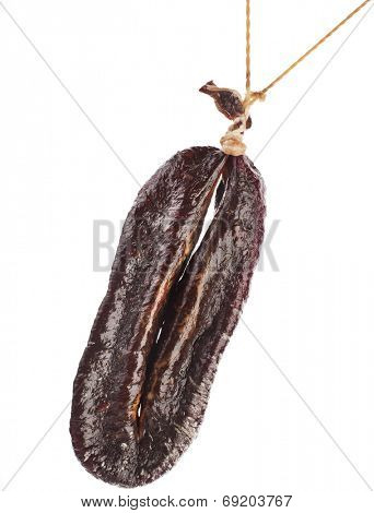 dried solid sausages Turkic sudzhuk hanging  isolated on white background