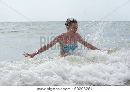 Girl In A Swimsuit At The Sea