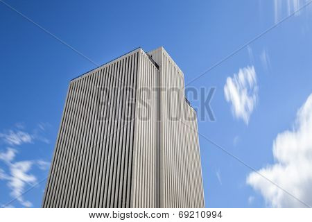 Skyscraper And Blue Sky With Clouds In The Move