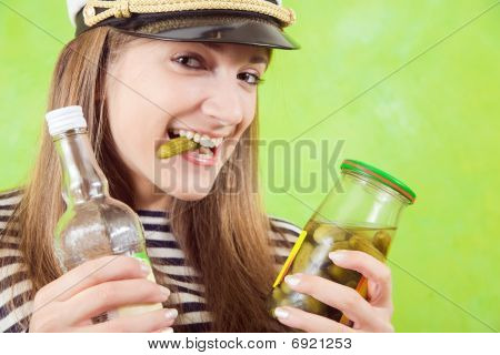 Female Sailor With Bottle Of Vodka And Pickle
