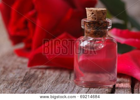Perfumed Rose Water In A Bottle On A Wooden Close-up
