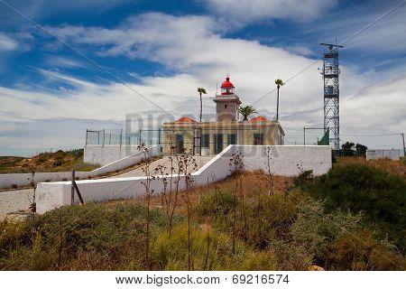 Ponta De Piedade Lighthouse Overlooking The Atlantic Ocean