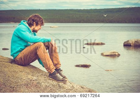 Young Man Relaxing Outdoor On Mountain With Lake On Background Summer Vacations And Lifestyle Hiking