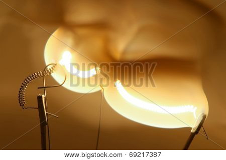 Close Up Glowing Light Bulb Thread