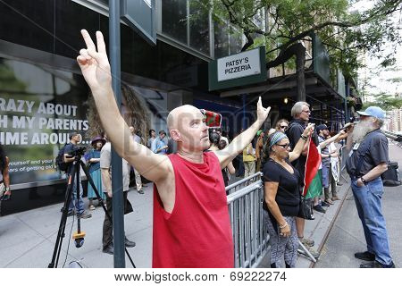 Activist before Israel Mission with arms raised