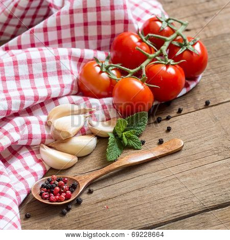 Tomatoes, Mint, Garlic And Pepper On Dark Wood And Dish Towel