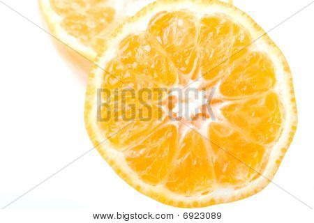 Fresh juicy delicious ripe clementine citrus fruit cut isolated