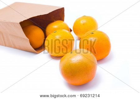 Six Oranges Falling From Paper Bag