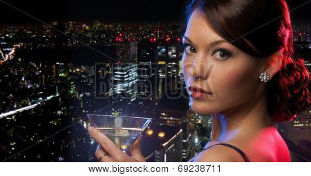 party, celebration, holiday and people concept - beautiful woman in evening dress with cocktail