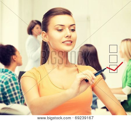 education and technology concept - student drawing checkmark on virtual screen