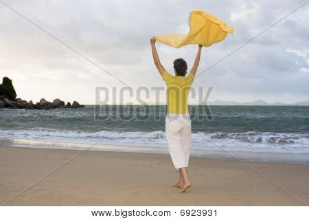 Happy Woman On A Beach