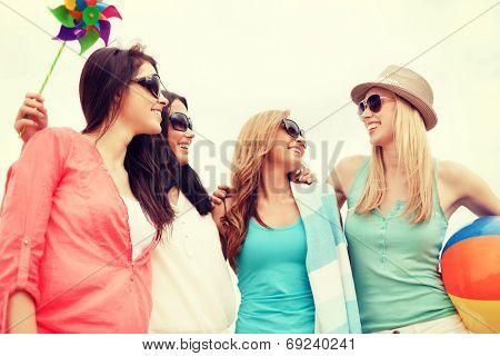 summer holidays, vacation and beach activities - girls having fun on the beach