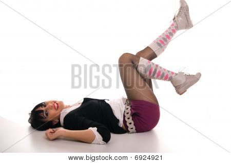Happy school girl lying on the floor
