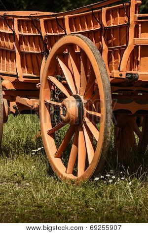Close up of a vintage cart or wagon wheel