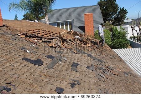Demolition and removal of an Old Asphalt Single roof that was installed over an old Cedar Shake Roof from the 1960's era. Roofs generally last about 20 years before needing to be replaced.