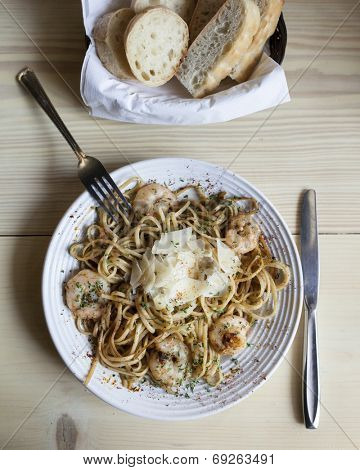 linguine with shrimp and bread, dinner table setting