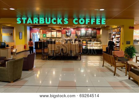 KUCHING - MAY 02: airport cafe interior on May 02, 2014 in Kuching, Malaysia. Starbucks is the largest coffeehouse company in the world, with 23,187 stores in 64 countries
