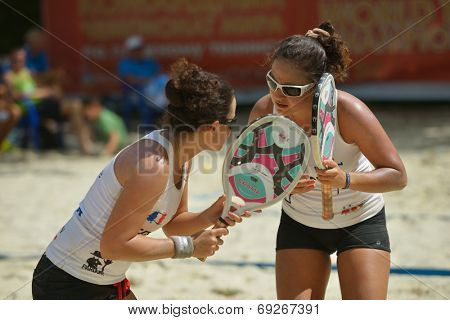 MOSCOW, RUSSIA - JULY 19, 2014: Woman double of France in the match against Belarus during ITF Beach Tennis World Team Championship. France won in two sets