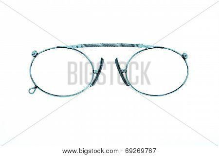 Antiquarian Eyeglasses On A White Background
