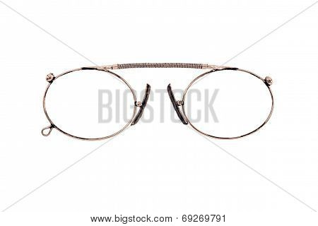 Copper Eyeglasses On A White Background