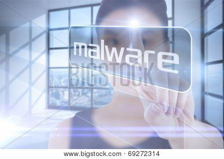 Businesswoman pointing to word malware against room with large window showing city