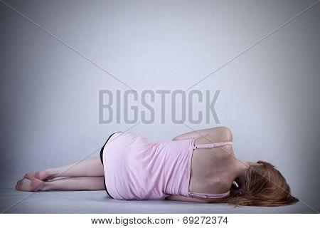 Skinny Girl Lying On The Floor