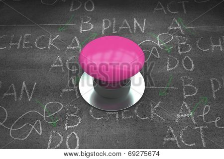 Pink push button against black wall