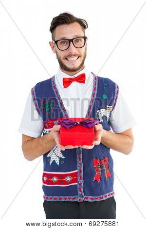 Geeky hipster offering christmas gift on white background