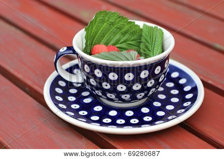 A cup from polish pottery in Bunzlau with raspberries