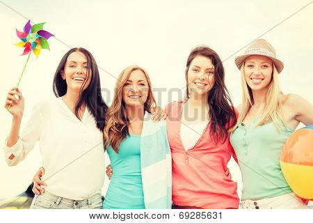 summer holidays, vacation and beach activities concept - smiling girls having fun on the beach
