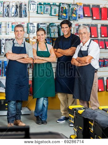 Portrait of confident salespeople smiling in hardware store